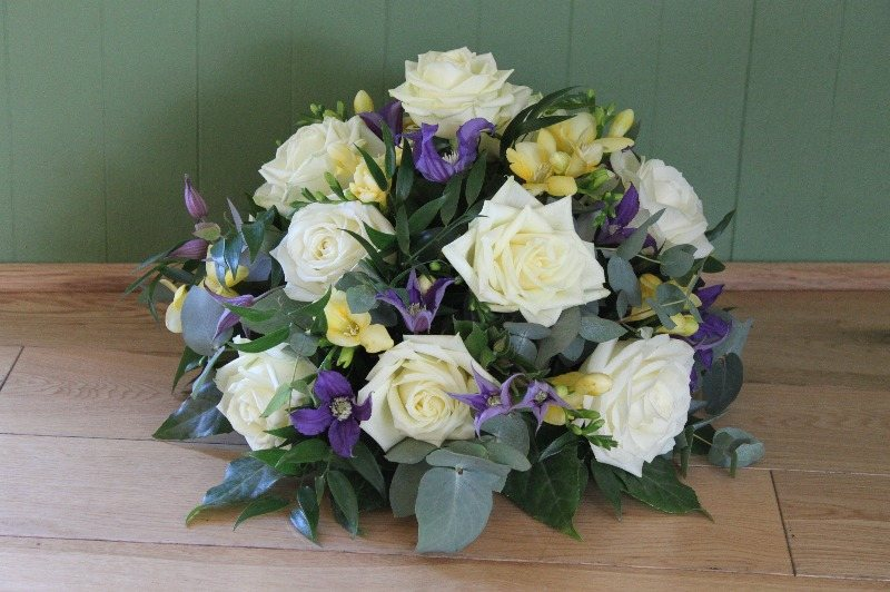 Ivory rose, purple clematis and yellow freesia posy