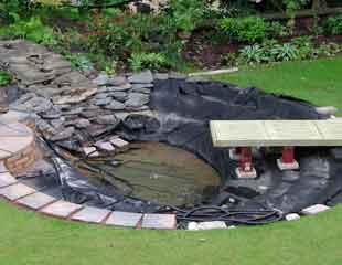 Garden Pond Edging Ideas natural pond with sleeper edge How To Build A Garden Pond