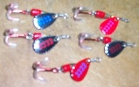 Spinner lure small with blood red treble.