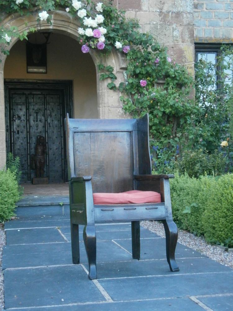 A George II Imposing Oak Wing Sided Armchair .