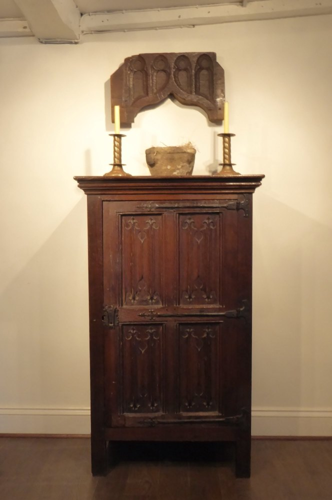 An English Tudor Carved Oak Linenfold Cupboard