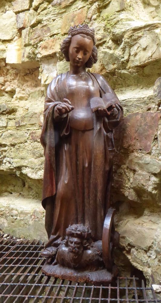 A Rare And Important 15th Century Carved Oak Figure Of St.Catherine With Im