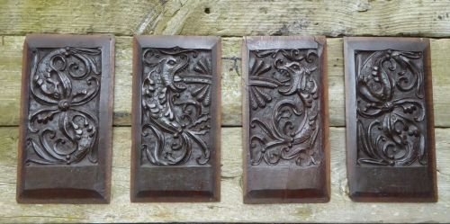 A Set Of Four Henry VIII Period Carved Oak Panels Of Fish Wyverns