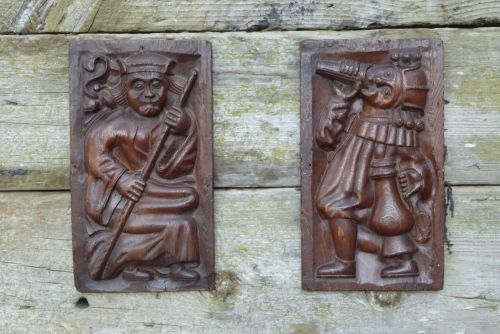 A Rare Pair Of 16th Century Carved Oak Panels Depicting Two Merry Gentlemen