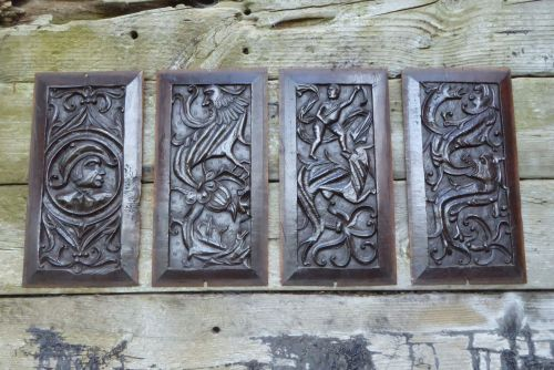 A Set Of Four Henry VIII Period Carved Oak Panels Depicting Dragons And Bea
