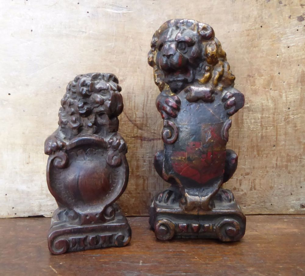 Two Early 17th Century Polychrome Carved Oak Seated Lions With Painted armorial Sold