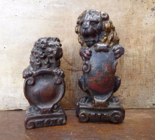 Two Early 17th Century Polychrome Carved Oak Seated Lions With Painted armo