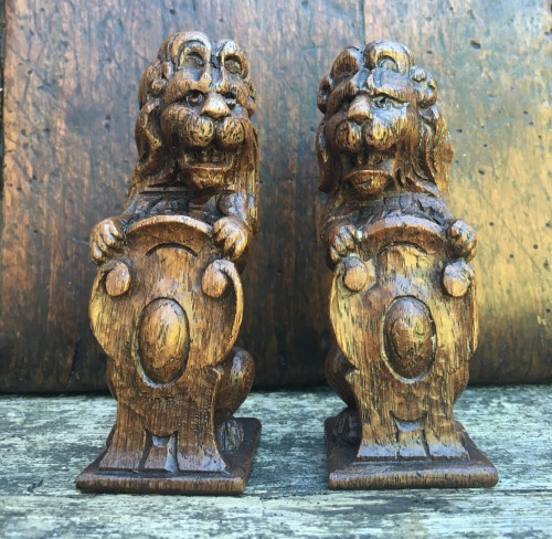 A Pair Of 17th Century Carved Oak Rampant Lion Finials
