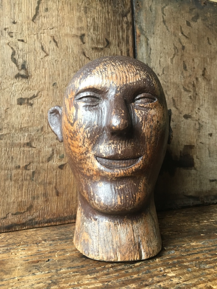 A Folk Art Carved Head possibly a lay figure or fair gound