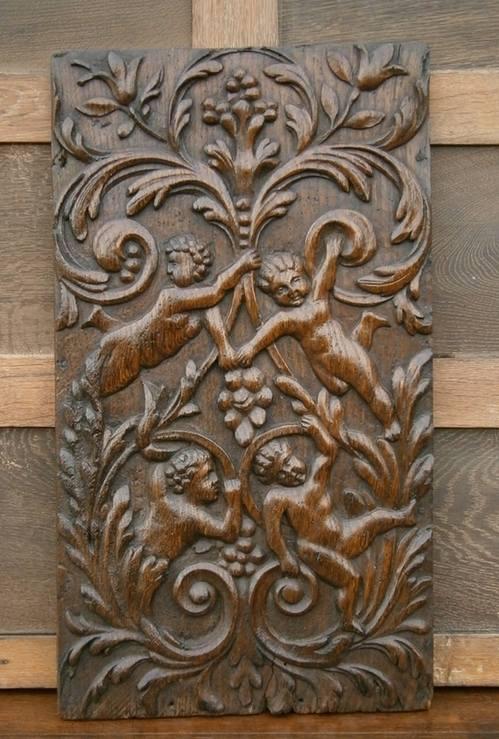 17th Century Flemish Carved Oak Panel Depicting Four Cherubs In Foliate Bor