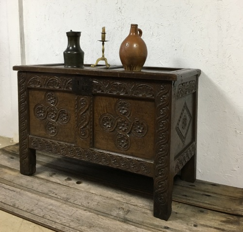 An Early 17th Century Carved Oak Coffer With Deep Carving.