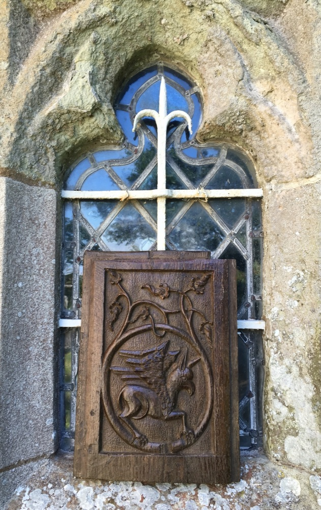 A Rare 16th century English carved oak panel Depicting a Wyvern
