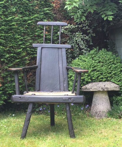 A truly wonderful 18th century primitve ash country chair with original gre