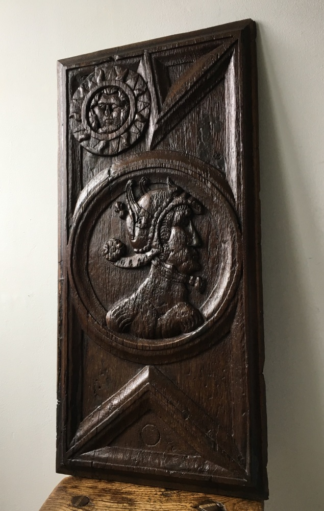 A Rare 16th Century Carved Oak Panel Depicting The God Mercury And The Sun