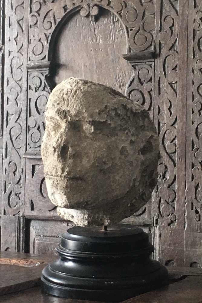 A Rare 15th Century Carved Stone Head,Possibly Depicting the decapitated Head Of St.Denis