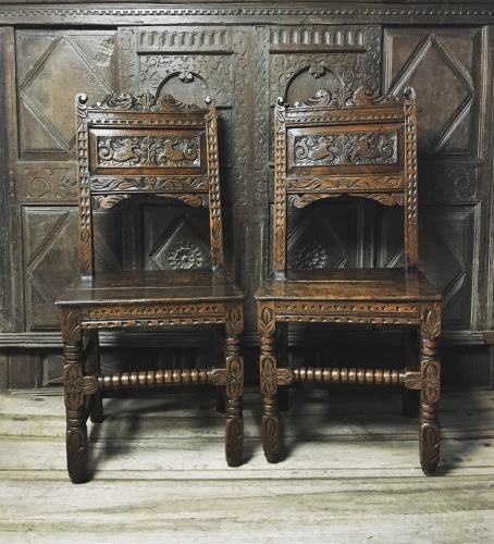 A Delightful Pair Of 17th Century Carved Oak Hall Chairs