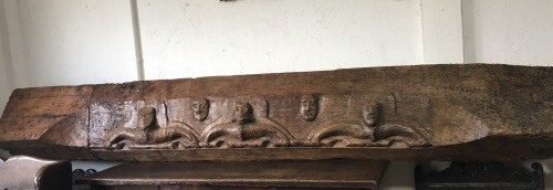 A Rare Early 16th Century Carved Oak Lintel Beam Depicting Four Male Heads