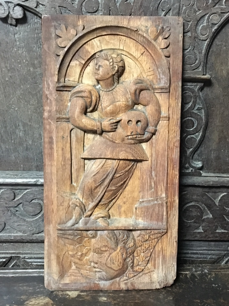 An Early 17th Century Carved Oak Panel Of A Saint Holding A Memento Mori Sk