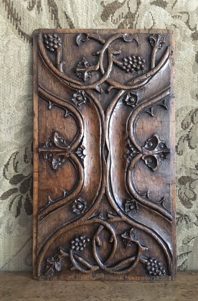A 16th Century Tudor Carved Oak Panel With Enriched Parchemin ornamentation