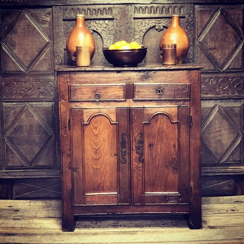 An Early 18th Century Country Oak Cupboard Of Joined Construction