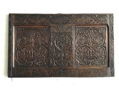 A 17th Century Carved Oak Chest Front Dated E.W.1675 From The Workshop Of T