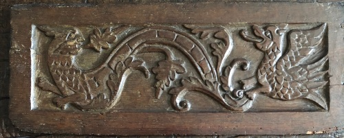 A Rare Early 17th Century Carved Oak Panel Depicting a Wyvern And A Dragon.