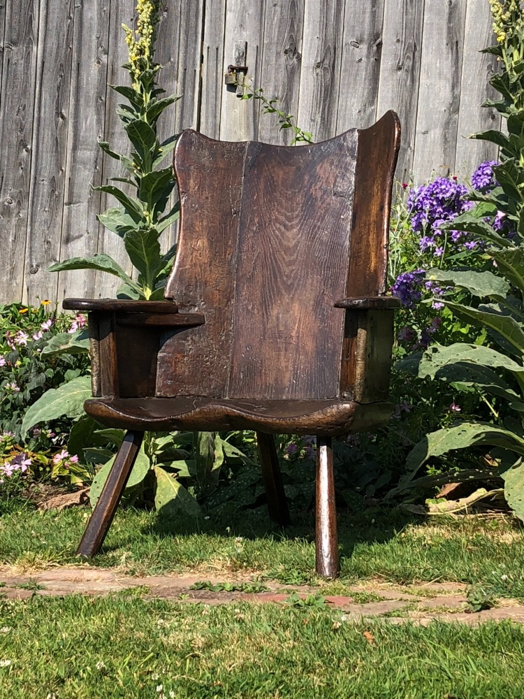 An Outstanding Example Of An 18th Century Welsh Primitive Wing Back Chair.