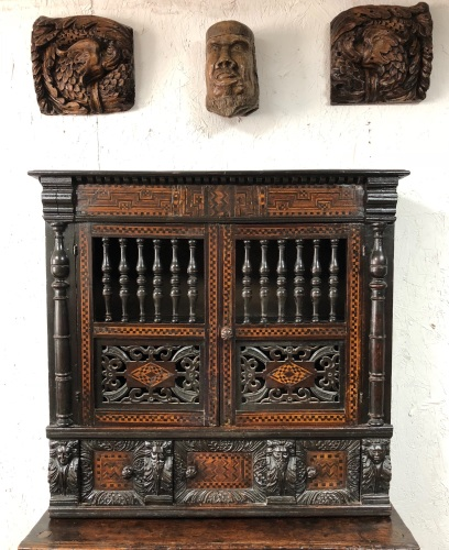 An Important Late Elizabethan Carved And Inlaid Oak Mural /Glass Cupboard