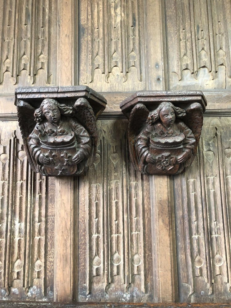 A Very Fine Pair Of Henry VII Carved Oak Angel Corbels Bearing The Coat Of