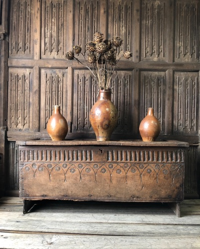 A  17th Century Carved Oak Board Chest .