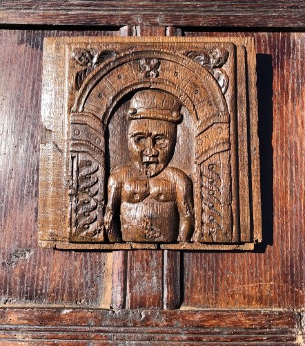 A Charming 16th Century Carved Oak Panel Depicting A Man Within An Arch.