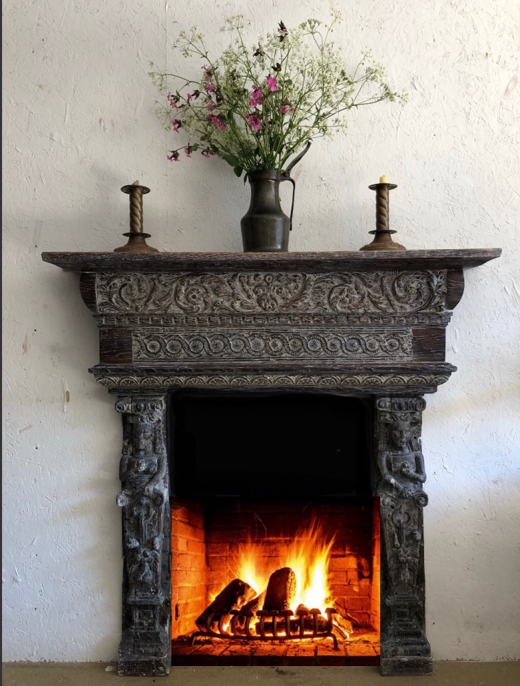 A Rare And Decorative Elizabethan Carved Oak Fire Surround