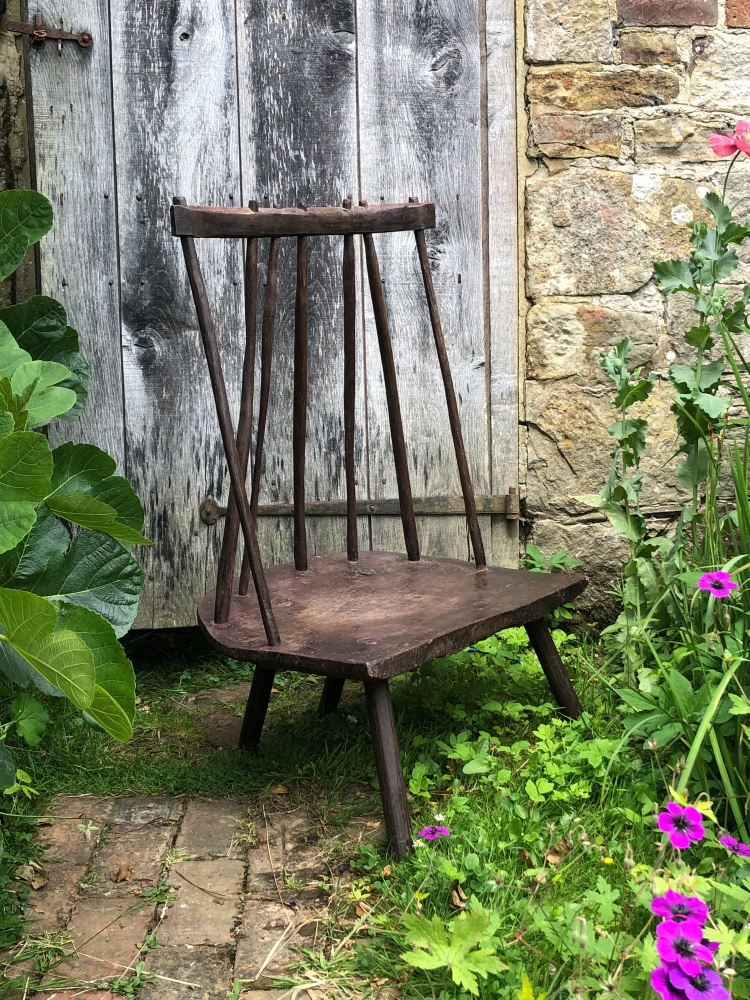 An 18th Century Sculptural Welsh Primitive Fire Side Chair Of Wide Proporti