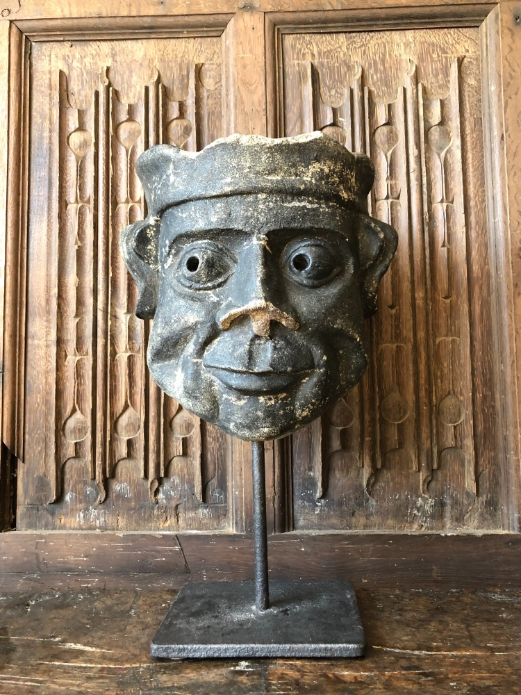 A Humorous 18th Century Carved Stone Gargoyle Head With A Cheeky Grin.