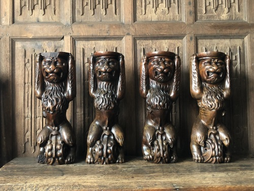 A Magnificent Set Of Four 16th century Carved Walnut Lions Seated On Grotes