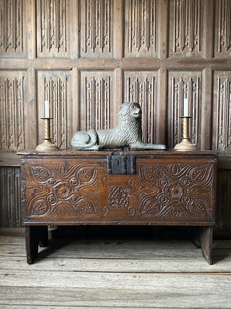 A 17th Century Carved Oak Boarded Chest Dated 1620 With The Noel Family Coat Of Arms Documented in The Dictionary Of English Furniture.