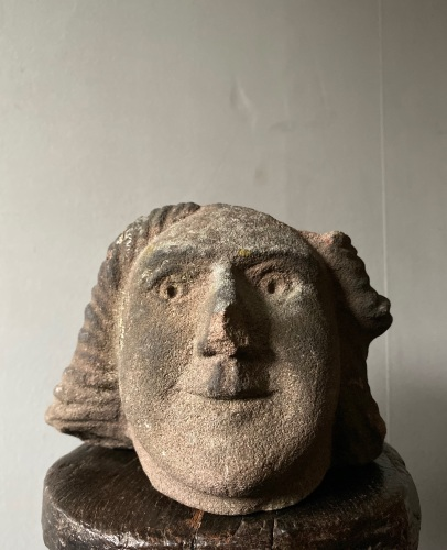 A 16th Century Carved Stone Head Of A Man .