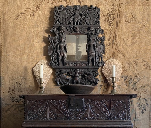 An Extremely Rare Late 17th Century Carved Oak Framed Mirror designed to ce