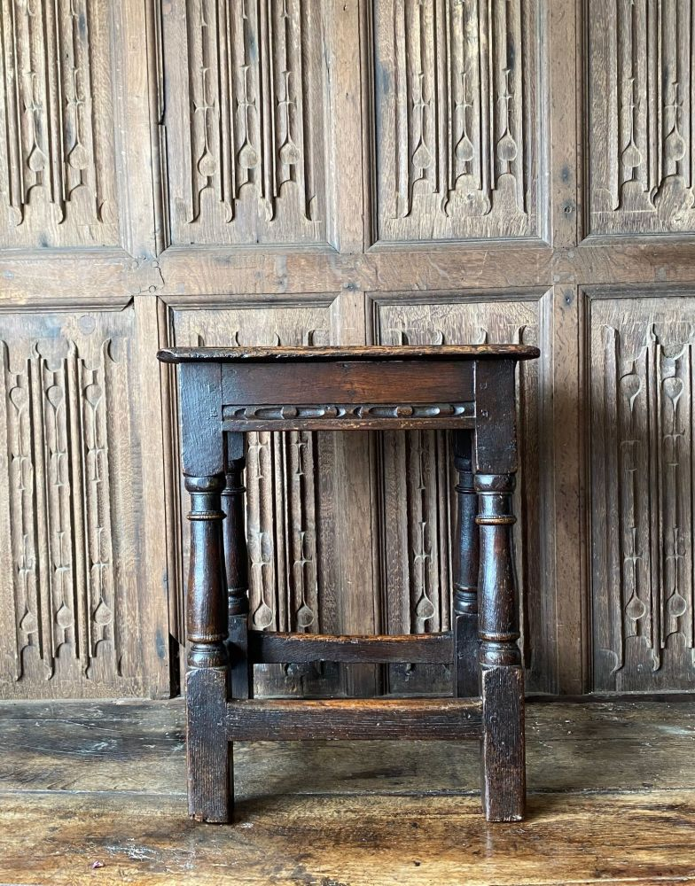 A Charles I Carved Oak Joined Stool.