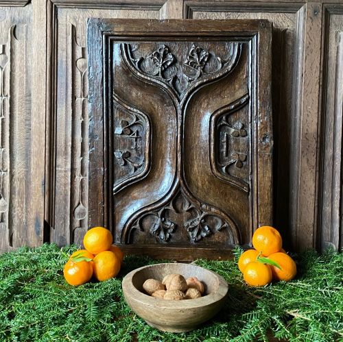 A 16th Century Carved Oak Parchemin Panel Door With Merchants mark.