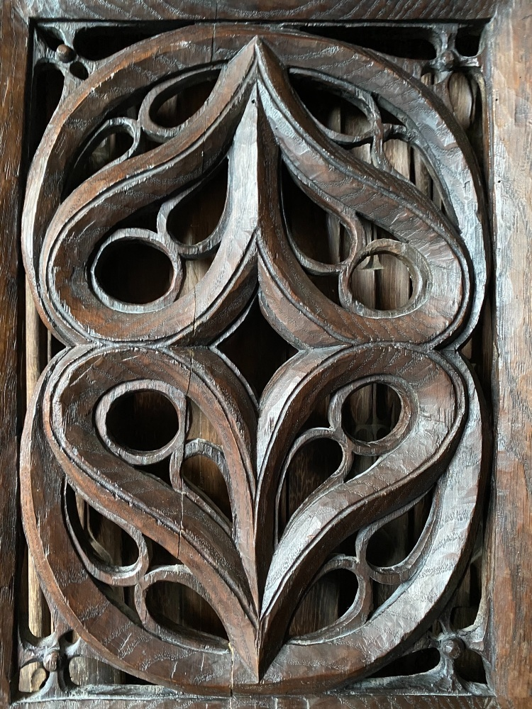 A Chunky 16th Century Chestnut Panel Carved With Pierced Tracery Design.
