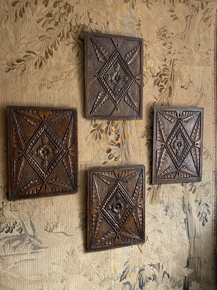 A Set Of Four 16th Century Carved Oak Panels From A Tudor Cupboard Door