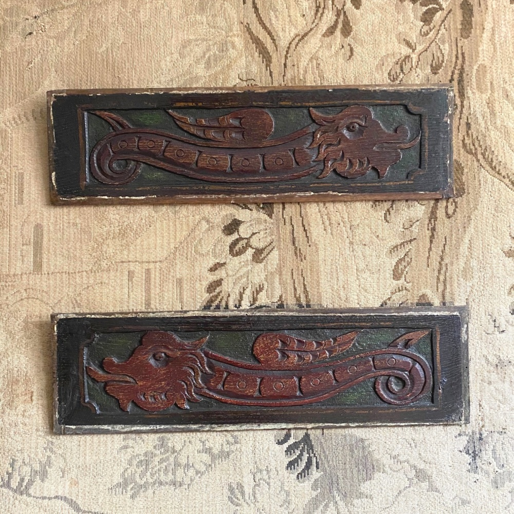 A Decorative Pair Of 17th Century Carved Oak Dragon Panels With Green And Red Paint.