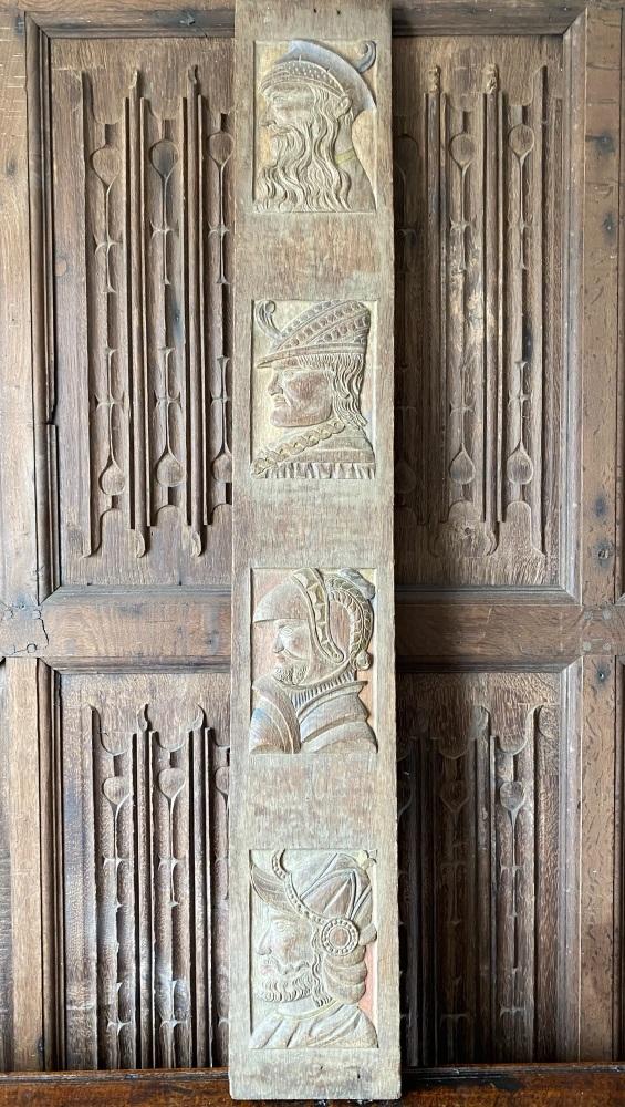 A Flemish Carved Oak Panel Depicting Four Male Profiles .