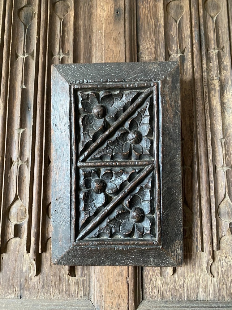 An English 16th Century Carved Oak Panel Depicting A Leaf And Bud Design.
