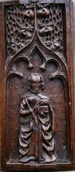 A 15th Century Carved Oak Panel Depicting St Thomas Under A Gothic Arch.