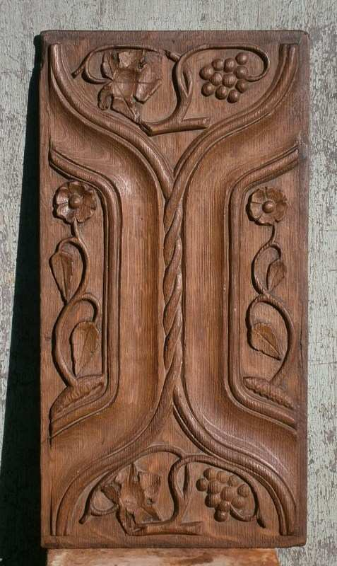 A 16th century English carved oak parchemin and linenfold panel