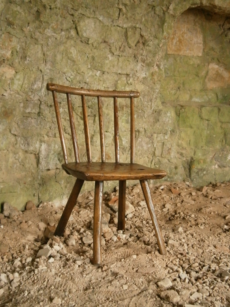 An Honest 18th Century Ash Hearth Chair Of Primitive Construction