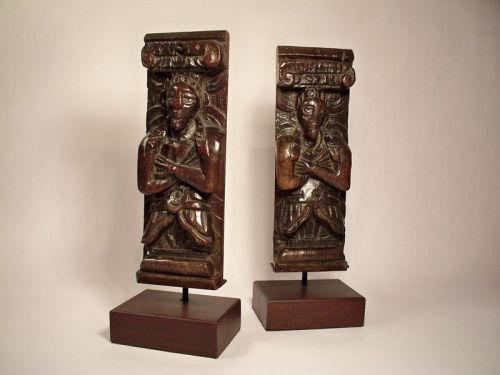 A pair of elizabethan carved oak caryatid figures