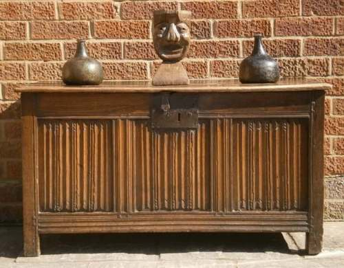 A 16th century English carved oak linenfold coffer